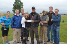 Anne and Kevin McGowan presenting a check to LNSA